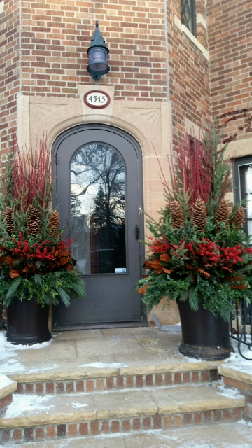Large winter pots flanking front entry