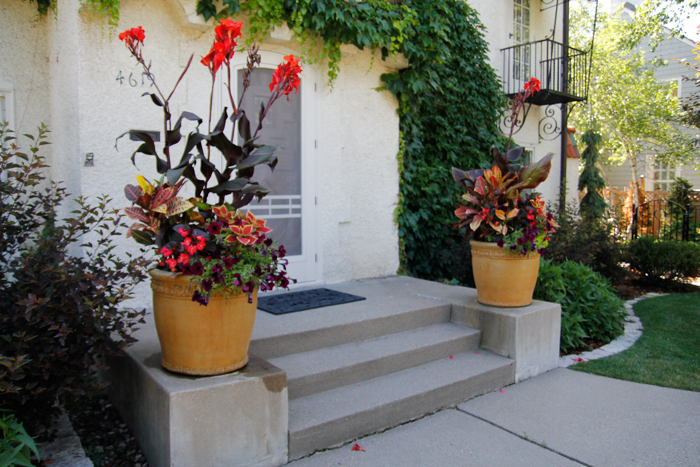 Annual planters flanking front porch