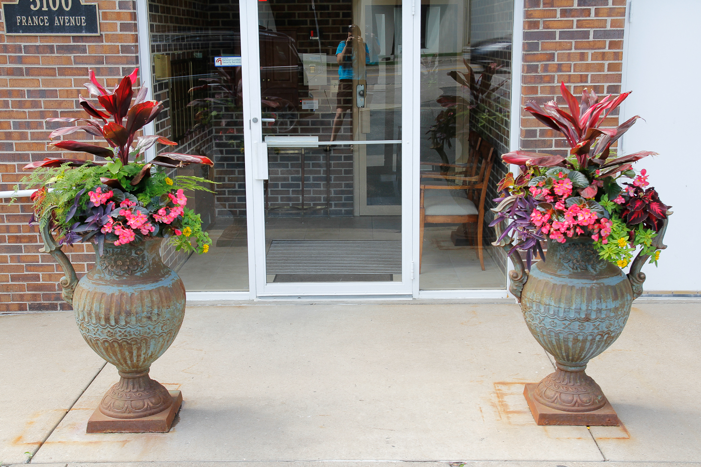 Urns with Annuals flanking business front door