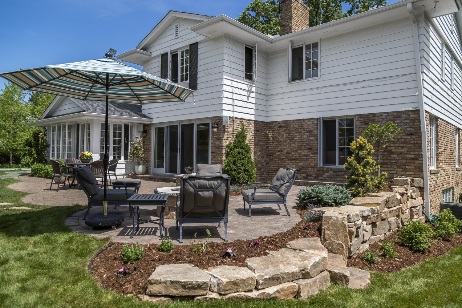 Patio with Natural Stone Retaining Wall
